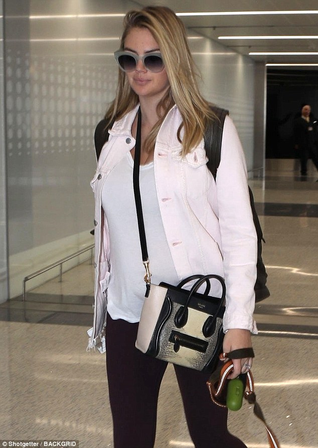 Kate Upton Covers Her Baby Bump at LAX